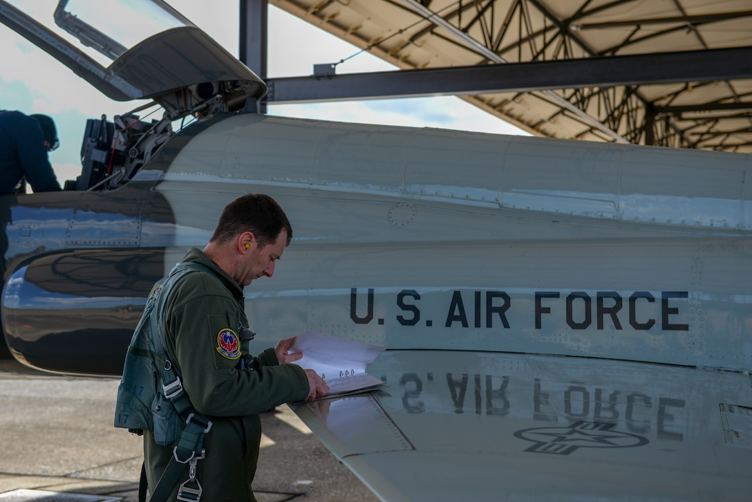 A 49th Fighter Training Squadron pilot conducts pre-flight checks on a T-38 Talon, Feb. 7, 2020, at Columbus Air Force Base, Mississippi. The pilot was a participant in exercise Southern Strike by providing aerial support in the T-38. The T-38 can reach the speed of 812 mph. (U.S. Air Force photo by Airman Davis Donaldson)