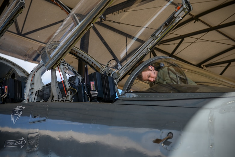A 49th Fighter Training Squadron pilot examines the interior of a T-38 Talon Feb 7, 2020, on Columbus Air Force Base, Miss. The pilot participated in exercise Southern Strike. More than 40 units participated in or supported Southern Strike in 2020. (U.S. Air Force photo by Airman Davis Donaldson)