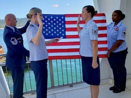 Reserve Airman reenlists at historic World War II memorial