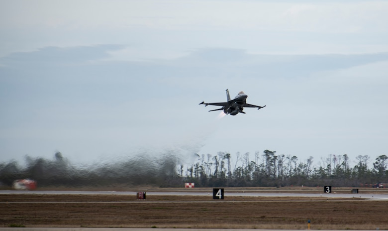 A U.S. Air Force F-16 Fighting Falcon from Holloman Air Force Base, N.M., takes off for a training flight at Tyndall Air Force Base, Fla., Feb. 4, 2020. Tyndall is one of the few bases in the Department of Defense that has access to the Eastern Gulf of Mexico training airspace, which is often used for air combat training and live missile testing. (U.S. Air Force photo by Senior Airman Stefan Alvarez)