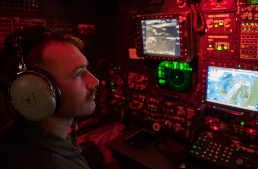 A U.S. Air Force 96th Bomb Squadron weapons systems officer monitors aircraft screens on a U.S. Air Force 2nd Bomb Wing B-52H Stratofortress during training and integration with the Royal Norwegian Air Force in support of Bomber Task Force Europe 20-1, Nov. 6, 2019, in Norwegian airspace. This deployment allows aircrews and support personnel to conduct theater integration and to improve bomber interoperability with joint partners and allied nations. (U.S. Air Force photo by Tech. Sgt. Christopher Ruano)