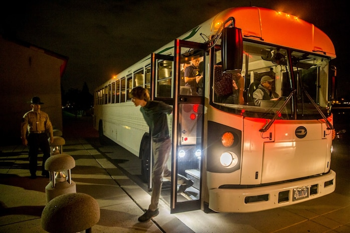 A new recruit with Alpha Company, 1st Recruit Training Battalion, steps off the bus during receiving at Marine Corps Recruit Depot, San Diego, Feb. 3, 2020.