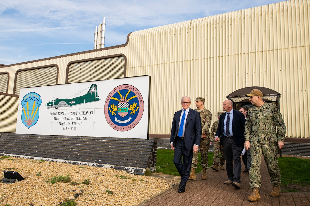 United States Ambassador to the United Kingdom, Robert Wood Johnson, (left), walks out of the Joint Intelligence Operations Center Europe Analytic Center, during a visit to RAF Molesworth, England, Feb. 7, 2020. Johnson visited RAF Molesworth, which is part of the 501st Combat Support Wing, to build more relationships with personnel and gain a better understanding of their overall mission, capabilities and comprehensive duties. (U.S. Air Force photo by Senior Airman Eugene Oliver)