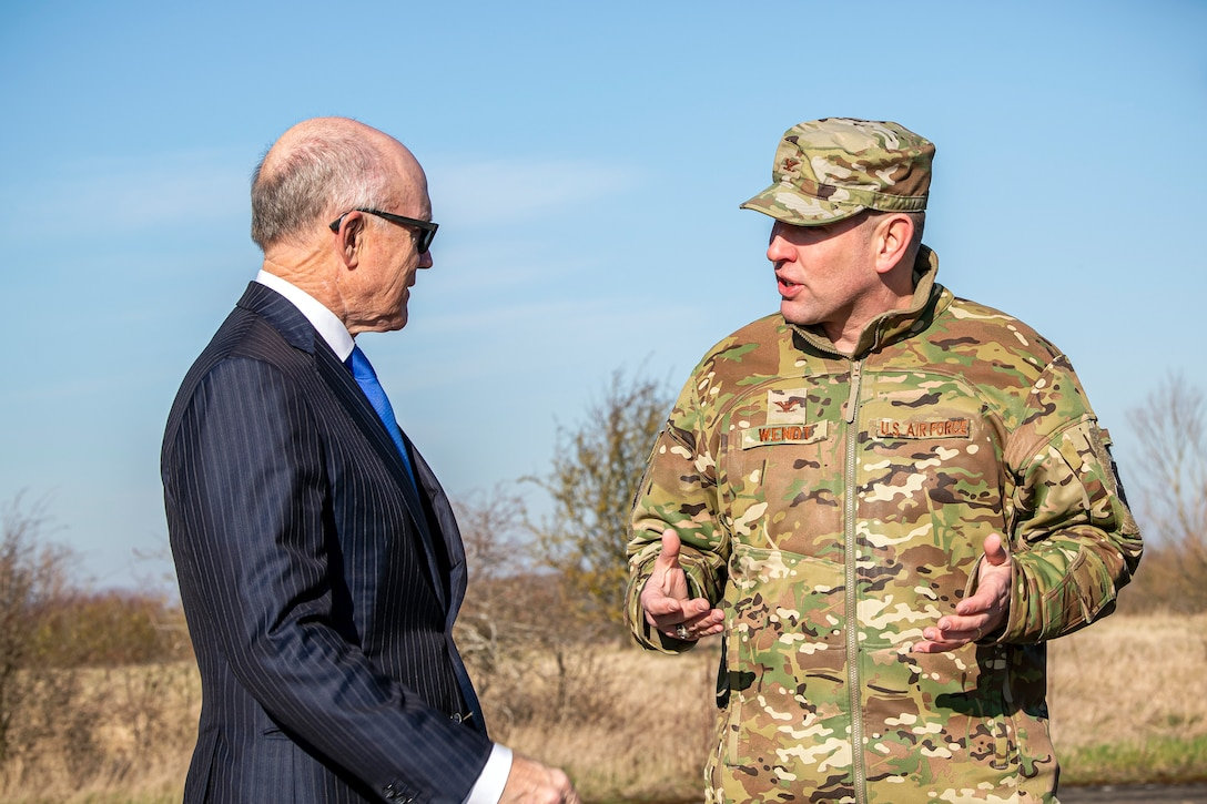 U.S. Air Force Col. Kurt Wendt, (right), speaks with United States Ambassador to the United Kingdom, Robert Wood Johnson, (left), during a visit to RAF Molesworth, England, Feb. 7, 2020. Johnson visited RAF Molesworth, which is part of the 501st Combat Support Wing, to build more relationships with personnel and gain a better understanding of their overall mission, capabilities and comprehensive duties. (U.S. Air Force photo by Senior Airman Eugene Oliver)