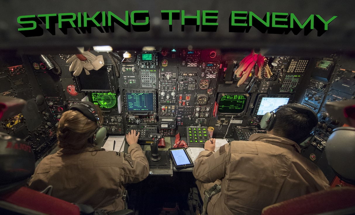 """U.S. Air Force Capt. """"Rannt"""" (left) and 1st Lt. """"Comic"""" (right), 96th Bomb Squadron weapons systems officers, perform constant checks on their controls inside a U.S. Air Force 2nd Bomb Wing B-52H Stratofortress in support of Bomber Task Force Europe 20-1, Nov. 4, 2019, over Greece Air Space. This deployment allows aircrews and support personnel to conduct theater integration and to improve bomber interoperability with joint partners and allied nations."""