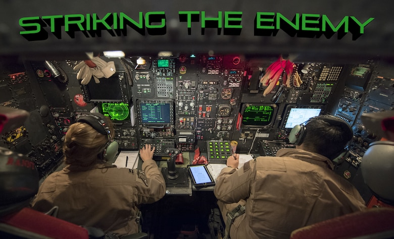 """U.S. Air Force Capt. """"Rannt"""" (left) and 1st Lt. """"Comic"""" (right), 96th Bomb Squadron weapons systems officers, perform constant checks on their controls inside a U.S. Air Force 2nd Bomb Wing B-52H Stratofortress in support of Bomber Task Force Europe 20-1, Nov. 4, 2019, over Greece Air Space. This deployment allows aircrews and support personnel to conduct theater integration and to improve bomber interoperability with joint partners and allied nations. (U.S. Air Force photo by Tech. Sgt. Christopher Ruano)"""
