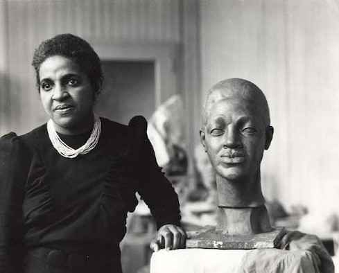 A nurse-turned-sculptor, most famous for inspiring the likeness of President Franklin D. Roosevelt on the U.S. dime, Selma Burke poses in her studio, New York, N.Y., circa 1940.
