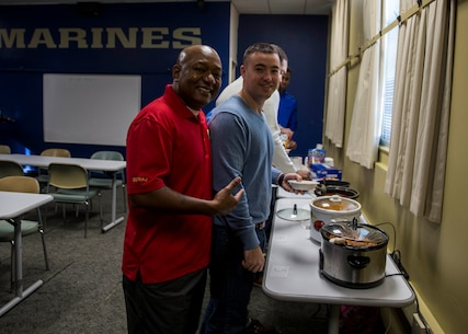 Sergeant Major William J. Banks III, sergeant major of 6th Marine Corps District , left, and Capt. Scott Holmes, adjutant of 6MCD, right, participate in judging the chili cook-off during Mission Day at the 6MCD Headquarters aboard Marine Corps Recruit Depot Parris Island, South Carolina, Jan. 17, 2020. Mission Day commemorates the hard work and dedication of the Marines, Sailors, and civilians of 6MCD. (U.S. Marine Corps photo by Cpl. Jack A. E. Rigsby)