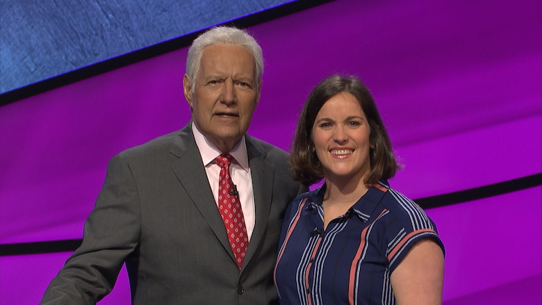 Mrs. Danyelle Long-Hyland, lab instructor assigned to United States Army Medical Research Institute of Infectious Disease, poses with Jeopardy host Alex Trebek. (courtesy photo)