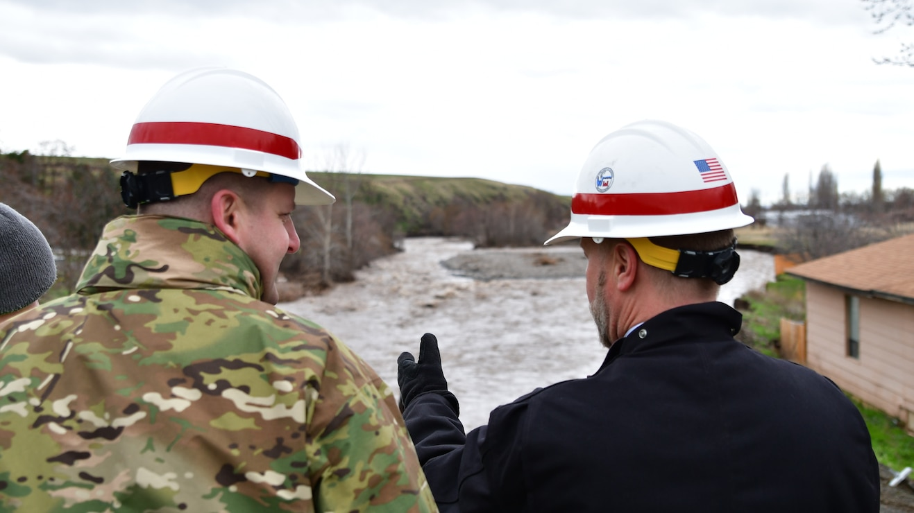 Lt. Col. Christian Dietz, Commander of the Walla Walla District Corps of Engineers, and the District's Chief of Engineering, Dwayne Weston, survey the erosion near Marie Dorion Park in Milton Freewater.