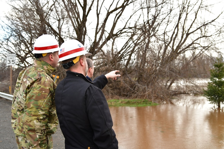 Lt. Col. Christian Dietz, Commander of the Walla Walla District Corps of Engineers, and the District's Chief of Engineering, Dwayne Weston, oversee Russel Creek in Walla Walla.