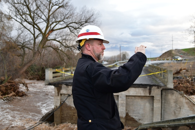The District's Chief of Engineering, Dwayne Weston examines Wallula Bridge off Old Hwy 12 in Walla Walla.