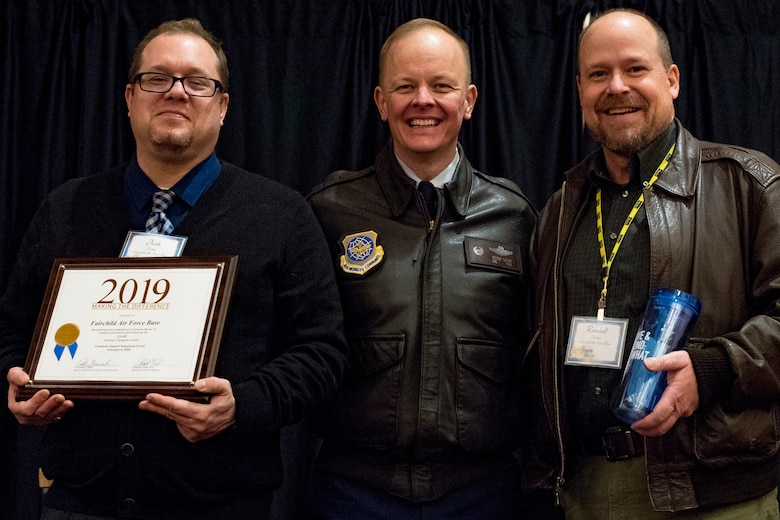(from left to right) Joshua Potter, 92nd Civil Engineer Squadron air program manager and employee transportation coordinator, U.S. Air Force Col. Derek Salmi, 92nd Air Refueling Wing commander, and Randy Parker, 92 ARW Alert Facility manager, attend the annual Commute Smart award ceremony in Spokane, Washington, Feb. 6, 2020. Team Fairchild was recognized for its efforts to improve traffic congestion, air pollution and fuel consumption in the year of 2019. (U.S. Air Force by Senior Airman Whitney Laine)