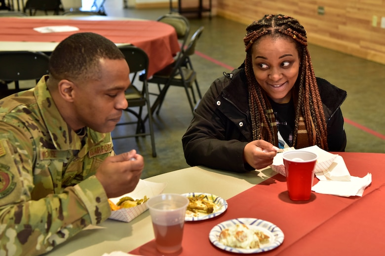 Airmen enjoy chicken curry with red beans and rice during A Taste of Culture event for Black History Month on Eielson Air Force Base, Alaska, Feb. 3, 2020. The event centered around Airmen tasting different African American dishes. (U.S. Air Force photo by Senior Airman Beaux Hebert)