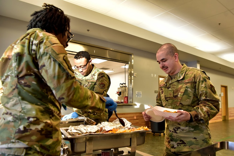 Airmen receive ethnic food at the A Taste of Culture event to celebrate Black History Month on Eielson Air Force Base, Alaska, Feb. 3, 2020. Yellow curry chicken, gumbo, red beans and rice were a few of the several dishes served at the event (U.S. Air Force photo by Senior Airman Beaux Hebert)