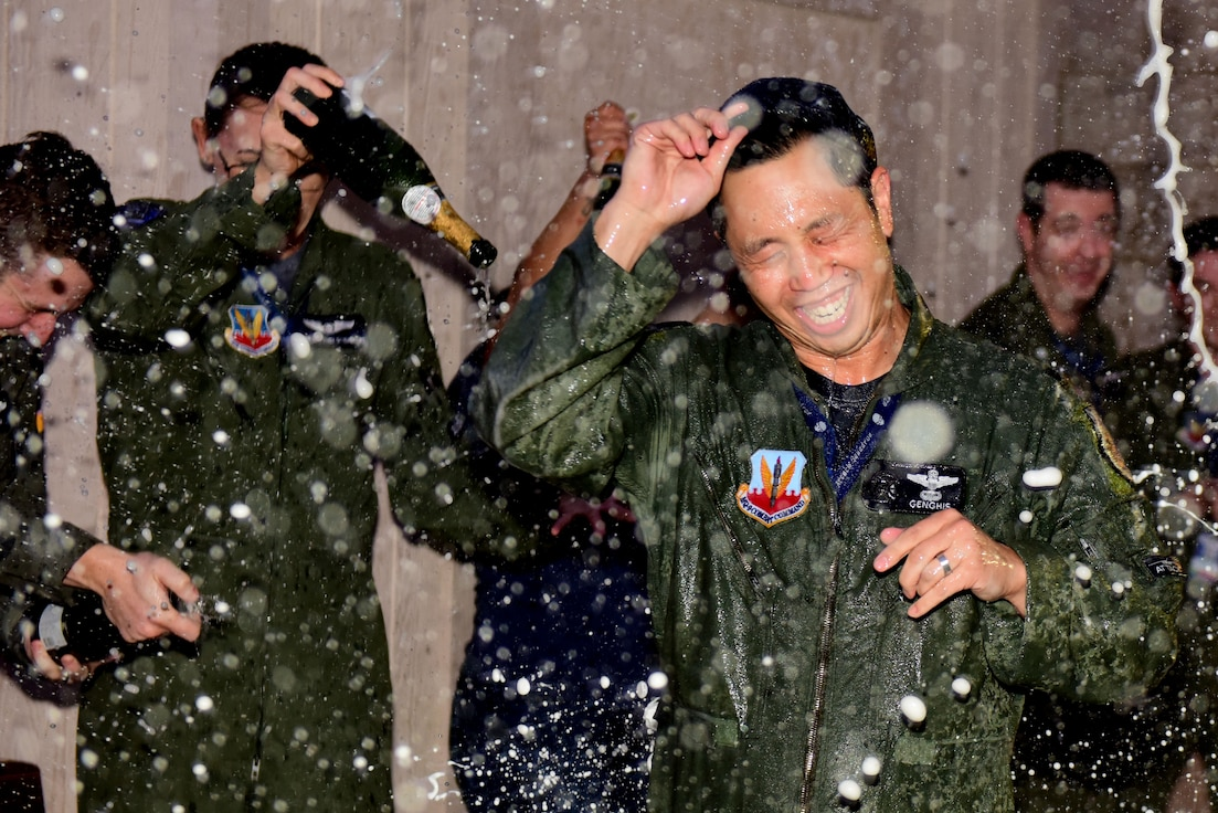 42nd ATKS commander is showered with champagne.