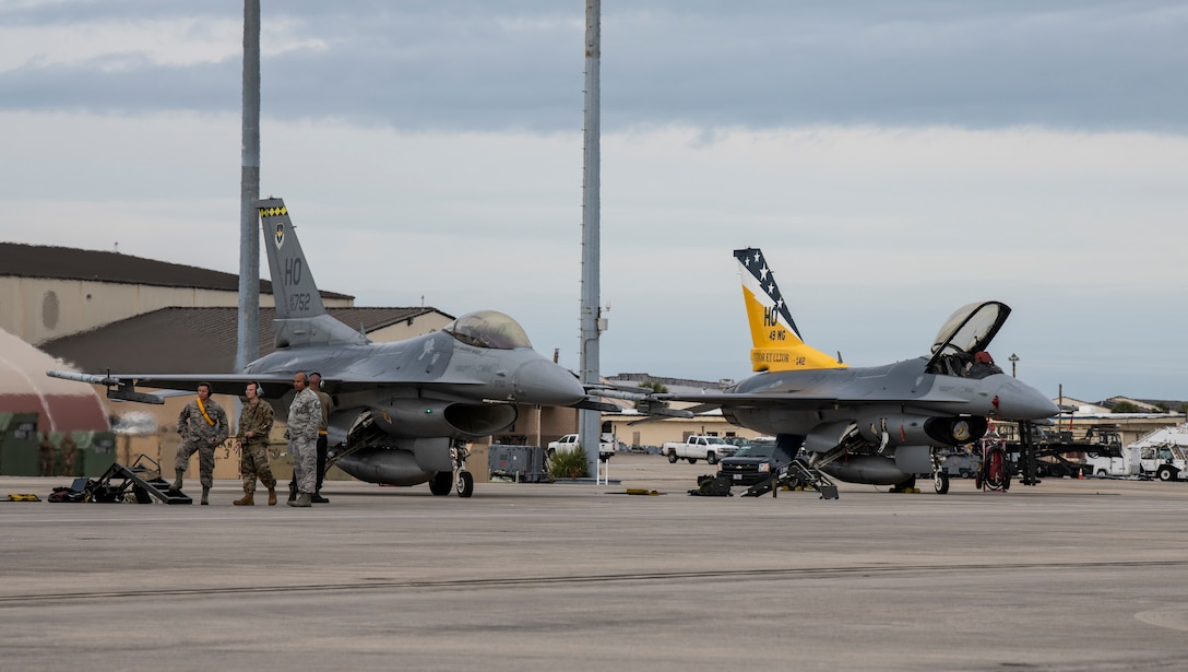 Two U.S. Air Force F-16 Fighting Falcons from Holloman Air Force Base, N.M., stand-by after a training flight at Tyndall Air Force Base, Fla., Feb. 4, 2020. The 325th Fighter Wing and 53rd Weapons Evaluation Group regularly host units from around the country for combat readiness evaluations. (U.S. Air Force photo by Senior Airman Stefan Alvarez