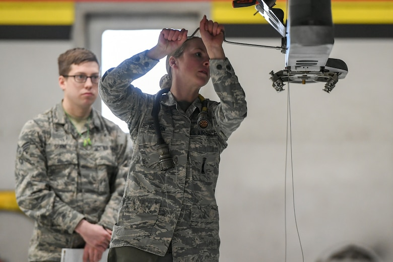 Airman prepares for a weapon load