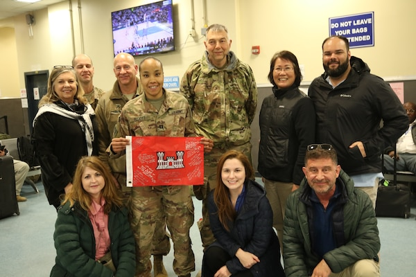 Members from the Programs and Project Management Division caught up with Cpt. Elliott at the terminal to present her with a few mementos of her time in theater.