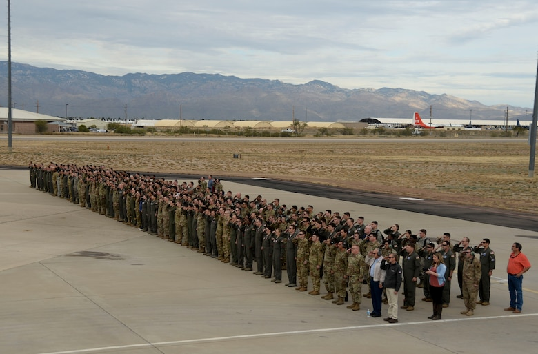 A group of Airmen stand in formation