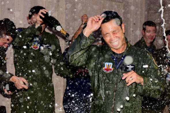 Lt. Col. Landon Quan is showered with champagne.