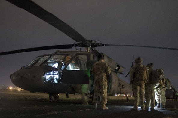 U.S. Air Force Special Tactics operators go over mission details with a U.S. Army UH-60 Black Hawk helicopter crew before conducting a direct action mission to kill or capture a high value individual during exercise Southern Strike 2020, at Camp McCain Training Center, Miss., Feb. 3, 2020. Southern Strike is a large-scale, joint and international combat exercise, featuring counter insurgency, close air-support, en-route casualty care, non-combatant evacuation and maritime special operations.
