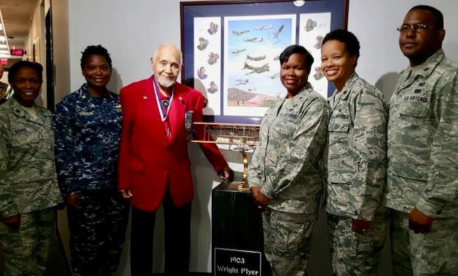 Retired U.S. Air Force Lt. Col. Leo Gray, third from left, poses for a photo with Maj. Natosha Reed, Air Command and Staff College student, third from right, and other military members during the ACSC's 2016 Gathering of Eagles event, Maxwell Air Force Base, Alabama, May 31, 2016.