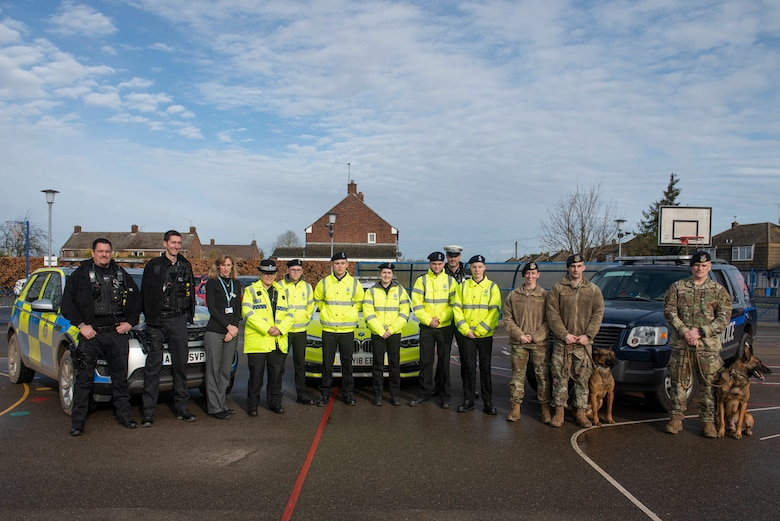 Attendees of the Mildenhall police cadets' open house pose for a group photo during an event in Mildenhall, England, Feb. 8, 2020. The open house was meant to recruit kids in the local area to join the police cadets, learn more about law enforcement and give them exciting opportunities. (U.S. Air Force photo by Staff Sgt. Luke Milano)