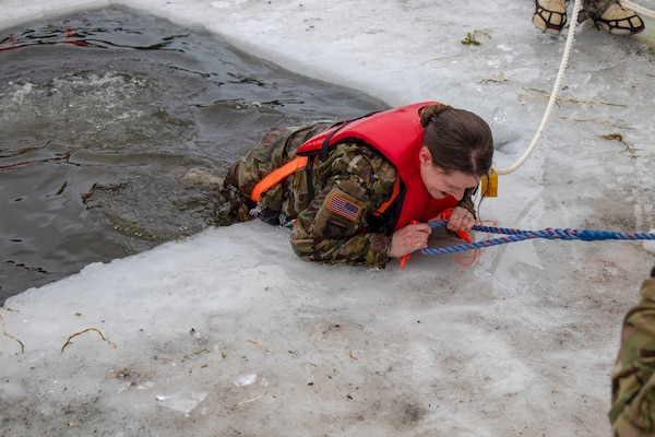 Alaska Army National Guard Command Sgt. Maj. Maureen Meehan, Joint Force Headquarters, participated in cold water immersion training organized by the 207th Engineer Utilities Detachment at Gwen Lake on Joint Base Elmendorf-Richardson, Alaska, Feb. 8, 2020. The training was developed to address the risk associated with the 207th EUD ice bridging project.