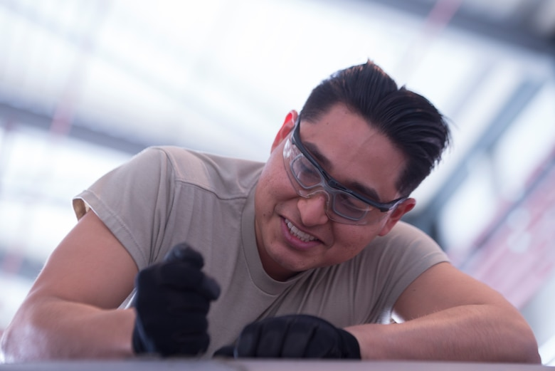 U.S. Air Force Airman 1st Class Ernesto Peralta-Carrion, 86th Maintenance Squadron aircraft inspection apprentice, scrapes sealant off a C-130J Super Hercules aircraft at Ramstein Air Base, Germany, Feb. 7, 2020. Sealant protects the wings of the planes from water and debris. The 86th MXS works around the clock to make sure the base's C-130's are maintained and ready to fly at all times.