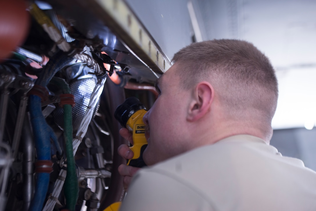 U.S. Air Force Staff Sgt. Aron Cuff, 86th Maintenance Squadron aircraft inspection craftsman, scans a C-130J Super Hercules aircraft engine for discrepancies at Ramstein Air Base, Germany, Feb. 7, 2020. The 86th MXS performs three levels of inspections before performing operational checks and releasing the aircraft back onto the flight line.The 86th MXS works around the clock to make sure the base's C-130's are maintained and ready to fly at all times.