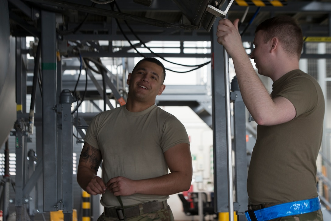 U.S. Air Force Staff Sgt. Chandler Bitterman, 86th Aircraft Maintenance Squadron dedicated crew chief, left, and Staff Sgt. Paul Michael, 86th Maintenance Squadron repair and reclamation craftsman, talk while working at Ramstein Air Base, Germany, Feb. 5th, 2020. Maintaining a C-130J Super Hercules aircraft requires the cooperation of various maintenance flights including engine, electrician, arrow repair, and wheel and tire flights. The 86th MXS works around the clock to make sure the base's C-130's are maintained and ready to fly at all times.