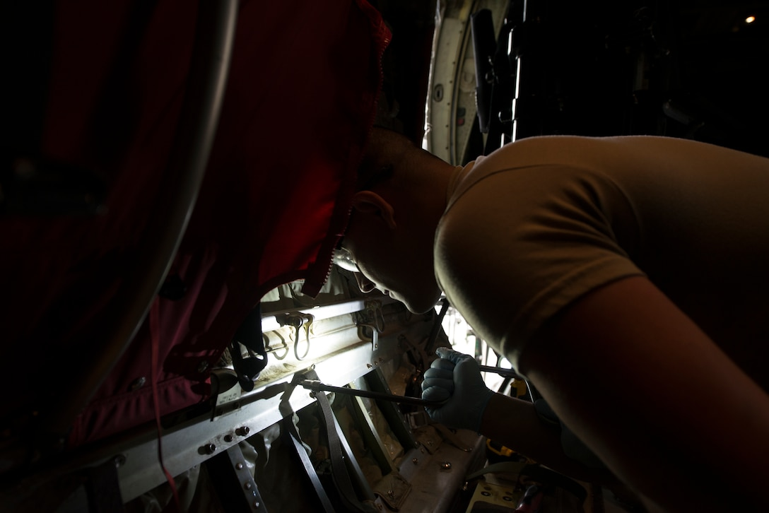 U.S. Air Force Staff Sgt. Chandler Bitterman, 86th Aircraft Maintenance Squadron dedicated crew chief, applies penetrating oil to the inside of a C-130J Hercules Super aircraft at Ramstein Air Base, Germany, Feb. 7, 2020. Penetrating oil loosens up screws within the aircraft to help locate faulty parts. The 86th MXS works around the clock to make sure the base's C-130J's are maintained and ready to fly at all times.