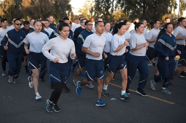 Airmen participating in group fitness exercises