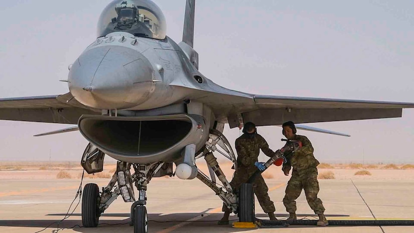 U.S. Airmen from the 380th Expeditionary Aircraft Maintenance Squadron remove a fuel hose from a U.S. Air Force F-16 Fighting Falcon during an engine-running refueling at Prince Sultan Air Base, Kingdom of Saudi Arabia, Feb. 7, 2020. Airmen at PSAB executed hot refueling capabilities by generating easily accessible fuel and rapidly returning the diverse aircraft set to the skies as part of an agile combat employment mission that exercised a critical capability of U.S. Air Forces Central Command. (U.S. Air Force photo by Senior Airman Giovanni Sims)