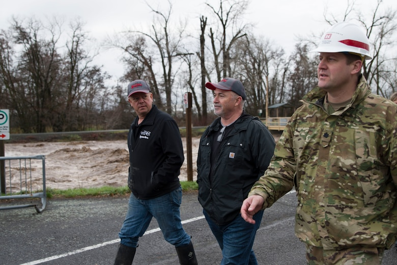 County Commissioners Todd Kimball and Greg Tompkins and Lt. Col. Christian Dietz, Commander of the Walla Walla District Corps of Engineers, travel along the Mill Creek Channel.
