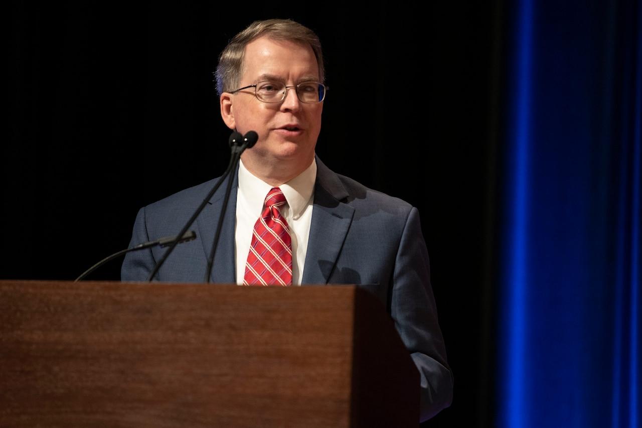 Deputy Defense Secretary David L. Norquist speaks from behind a dias.