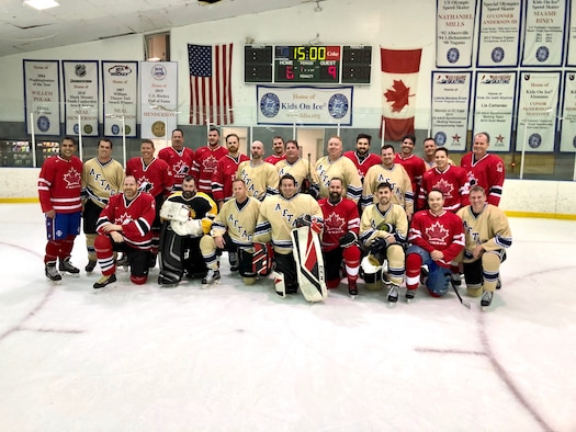 Members of the Air Force Technical Applications Center and Canadian Embassy hockey teams pose for a post-game group photo Jan. 31, 2020 after the Florida-based AFTAC team traveled to Washington D.C., for a match-up against the Canadians based in the nation's capital.   (U.S. Air Force photo by Jason Nehmer)