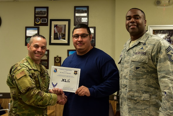 "Rene Martinez, a 47th Maintenance Squadron aircraft mechanic, was chosen by wing leadership to be the ""XLer"" of the Week, Feb. 3, 2020, at Laughlin Air Force Base, Texas. The ""XLer"" award, presented by Col. Lee Gentile, 47th Flying Training Wing commander, and Chief Master Sgt. Robert L. Zackery III, 47th FTW command chief master sergeant, is given to those who consistently make outstanding contributions to their unit and the Laughlin mission. (U.S. Air Force photo by Senior Airman Anne McCready)"