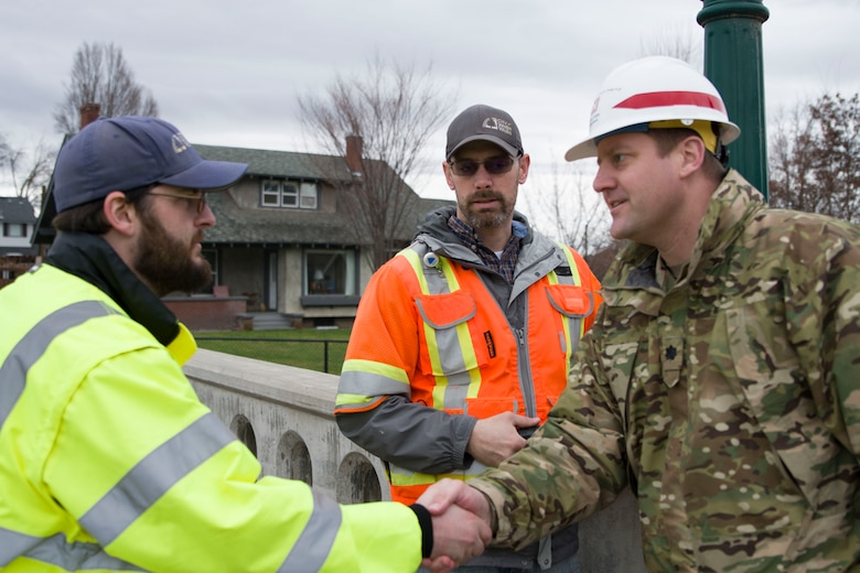 Lt. Col. Christian Dietz, Commander of the Walla Walla District Corps of Engineers greets Walla Walla City workers who are monitoring the Mill Creek Channel.