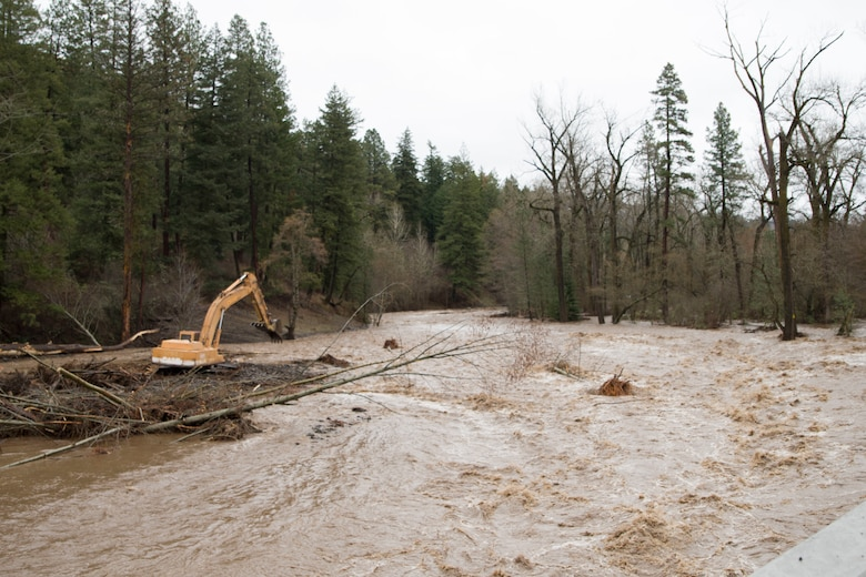 An excavator removes debris from the Mill Creek Channel.