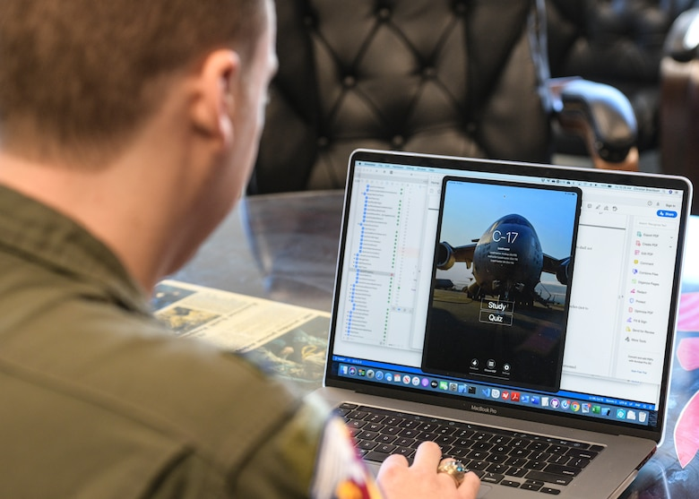 Capt. Christian Brechbuhl, an assistant flight commander assigned to the 16th Airlift Squadron, working on an application he developed to help aircrews study for annual certifications at Joint Base Charleston, S.C., Feb. 7, 2020.  The application was cost-effectively developed by Airmen from multiple bases who volunteered their time to write the code. It centralized necessary study material for aircrew members' annual certification material and is currently being utilized by three mobility airframes throughout Mobility Air Forces.