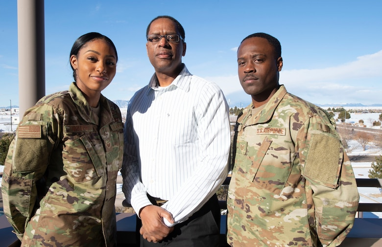 Schriever Air Force Base, Colo. — Staff Sgt. LaToya Walker, left, 50th Space Wing Equal Opportunity advisor, Edward Vaughn, 50th SW EO chief, center, and Tech. Sgt. Darren Woods, 50th EO noncommissioned officer in charge, right, stand together for a photo at Schriever Air Force Base, Colorado, Feb. 12, 2020. The 50th EO office promotes diversity and inclusion for the workforce within the Department of Defense, promoting a healthy work climate across the installations. (U.S. Air Force photo by Staff Sgt. Matthew Coleman-Foster)
