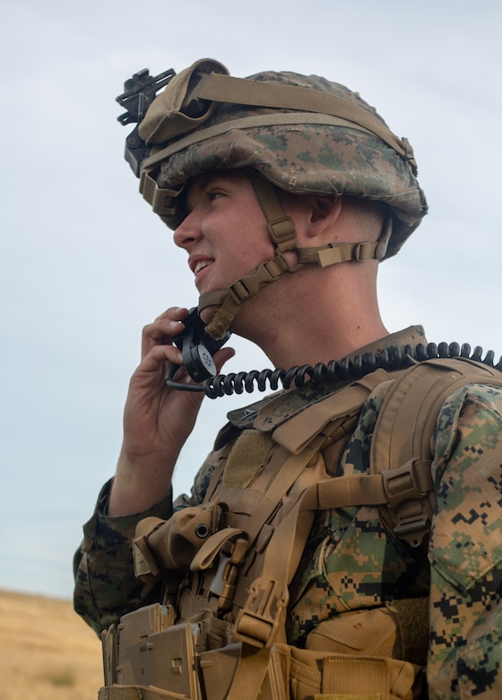 U.S. Marine Corps Lance Cpl. Michael Campillo, a mortarman with 1st Battalion, 2nd Marine Regiment, 2nd Marine Division, calls in a fire mission for mortars during Exercise Fireball Eagle at Marine Corps Air Station Cherry Point, N.C., Feb. 4, 2020. The training consisted of multiple scenarios using aircraft and ground support fire to simulate real warfighting situations. (U.S. Marine Corps photo by Lance Cpl. Brian Bolin Jr.)
