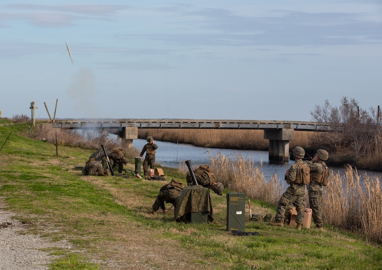 U.S. Marines with 1st Battalion, 2nd Marine Regiment, 2nd Marine Division, fire M252 81mm mortars during Exercise Fireball Eagle at Marine Corps Air Station Cherry Point, N.C., Feb. 5, 2020. The training consisted of multiple scenarios using aircraft and ground support fire to simulate real warfighting situations. (U.S. Marine Corps photo by Lance Cpl. Brian Bolin Jr.)