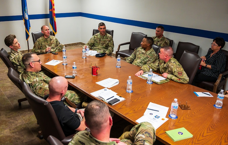 Col. Leonard T. Rose, Air Education and Training Command, Chief of Security Forces, (Left) speaks to Luke Defenders during a round-table discussion Jan. 29, 2020, at Luke Air Force Base, Ariz.