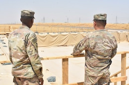 1st Lt. Darryl Grandberry, forward logistics element officer in charge, and Col. Jake kwon, 77th Sustainment Brigade Commander, inspect and review the layout and construction of a fuel site at Erbil Airbase, Iraq, Aug. 20, 2019.