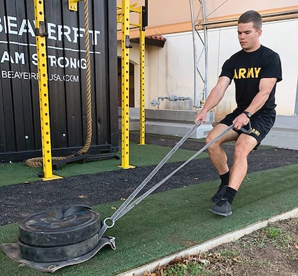 2nd Lt. David Cummings drags weight