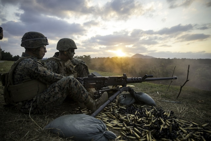 U.S. Marine Corps Cpl. Jacob Salas, an ammunition technician assigned to Headquarters Company, Headquarters Battalion, 3d Marine Division, fires an M2 .50 caliber machine gun at Camp Schwab, Okinawa, Japan, Feb. 6, 2020. Salas was participating in a mixed weapons range held for Marines who are attached to security platoon. During the range, the Marines fired thousands of rounds to increase and maintain proficiency with a variety of weapons systems.