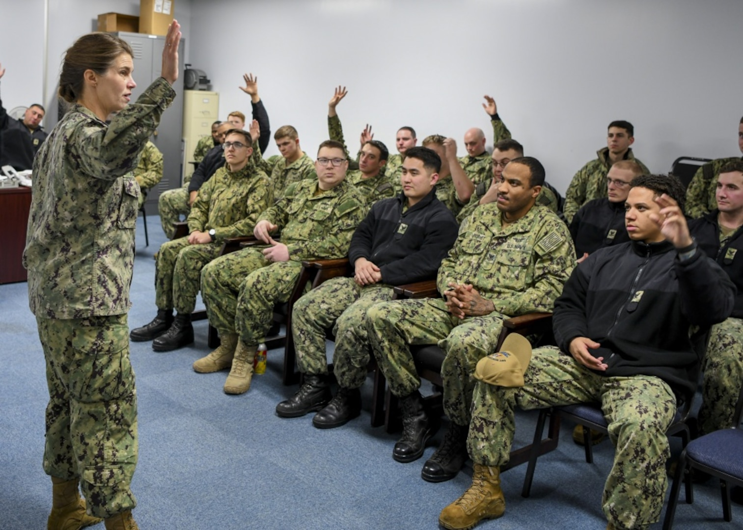 Rear Adm. Kristen B. Fabry, director, Logistics, Fleet Supply and Ordnance, U.S. Pacific Fleet, speaks with Sailors from Navy Munitions Command East Asia Division (NMCPAC EAD) Unit Misawa during a tour of the command. NMCPAC EAD maintains underwater mines, torpedoes, and provides ordnance sentencing, inspection and handling in support of aviation ordnance operations.